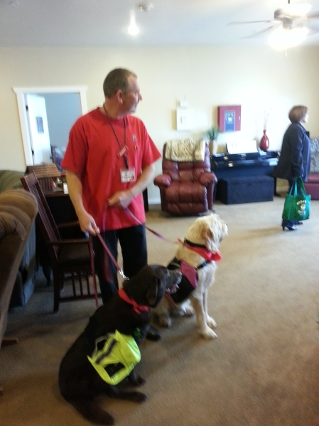 "Sophie and Elvis wear backpacks to deliver Mary Kay gifts for ""Adopt a Grandparent for Christmas""."